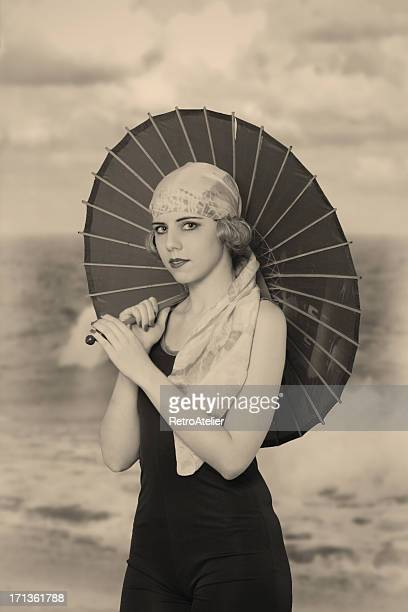 Flapper girl. Under umbrella