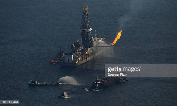 A flare burns from a drill ship recovering oil from the ruptured British Petroleum oil well over the site in the Gulf of Mexico on June 9 2010 off...
