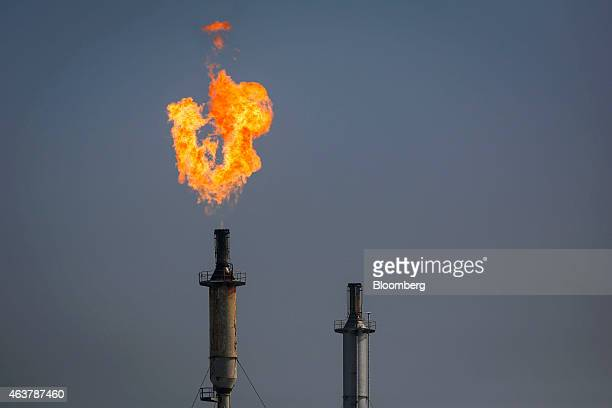 A flare burns over the Exxon Mobil Corp Torrance refinery after an explosion and fire in Los Angeles California US on Wednesday Feb 18 2015 An...