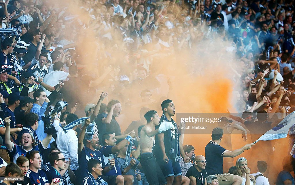 A flare is ignited in the Melbourne Victory supporters area of the crowd during the round 19 ALeague match between Melbourne City FC and Melbourne...
