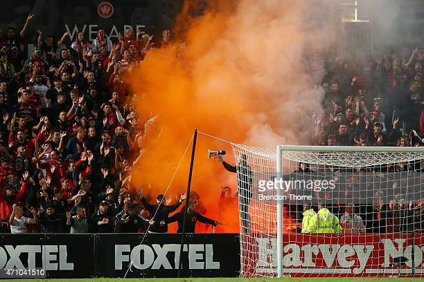 A flare is lit amongst Wanderers fans during the round 27 ALeague match between the Western Sydney Wanderers and the Perth Glory at Pirtek Stadium on...