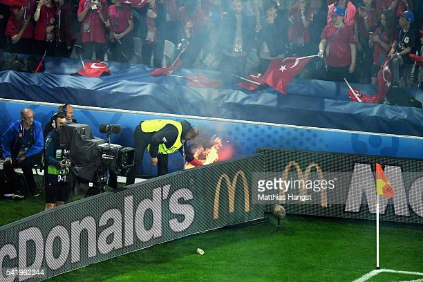 A flare is put out by a steward during the UEFA EURO 2016 Group D match between Czech Republic and Turkey at Stade BollaertDelelis on June 21 2016 in...