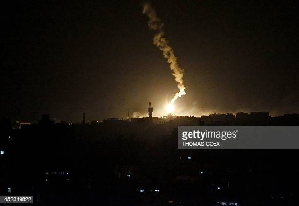 A flare sent by Israeli army illuminates the eastern part of Gaza City on July 18 2014 Israel warned it could broaden a Gaza ground assault aimed at...