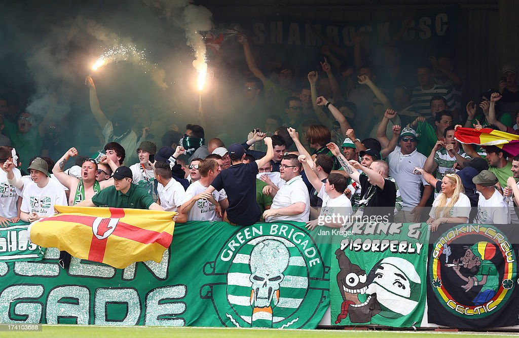 Flares are lit in the stand during a pre season friendly match between Brentford and Celtic at Griffin Park on July 20, 2013 in Brentford, England.
