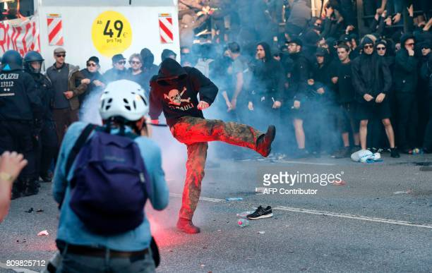 Flares are thrown at Riot police during the 'Welcome to Hell' rally against the G20 summit in Hamburg northern Germany on July 6 2017 Leaders of the...