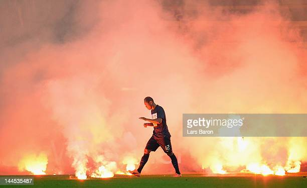 Flares burn on the pitch next to Ronny of Berlin during the Bundesliga Relegation second leg match between Fortuna Duesseldorf and Hertha BSC Berlin...