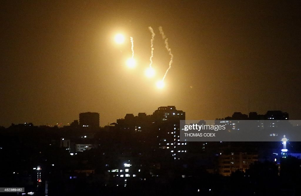 Flares fired by the Israeli army illuminate the sky over the northern part of Gaza City, on July 19, 2014. Israel's operation against Hamas saw one of its bloodiest days with 46 Palestinians killed in Gaza and two Israeli soldiers dying in a clash with militants who infiltrated the Jewish state. As Israeli warplanes bombarded Gaza from the air, and ground troops pressed an assault on land, the Palestinian death toll rose to 342, with rights groups warning that a growing number of victims are children.