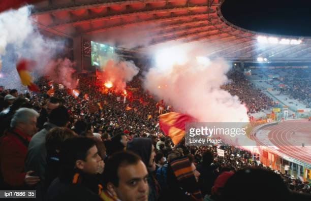 Flares in Curva Sud stand at Champions League Game Stadio Olimpico, Rome, Italy