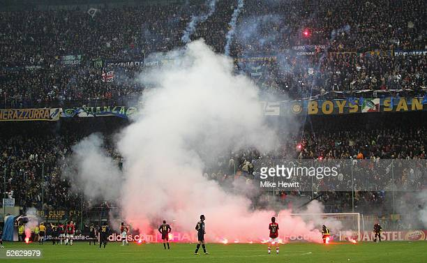 Flares rain down onto the pitch from Inter Milan fans during the UEFA Champions League quarterfinal second leg betweenInter Milan and AC Milan at the...