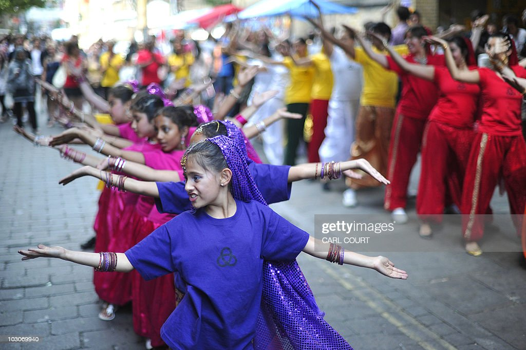 A flash mob of 50 Bollywood style dancers perform in Brick Lane, London, on July, 24, 2010, to promote the Nokia Conspiracy for Good project which involves collecting toys for a school in Zambia. AFP Photo / Carl Court