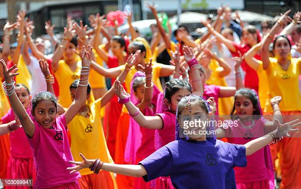 A flash mob of 50 Bollywood style dancers perform in Brick Lane London on July 2010 to promote the Nokia Conspiracy for Good project which involves...