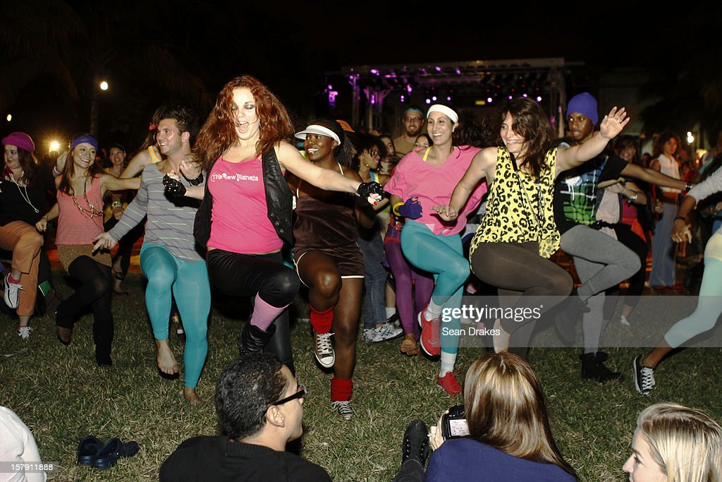 A Flashdance-styled flash mob performs in Collins Park at Art Basel Miami on December 5, 2012 in Miami Beach, Florida.