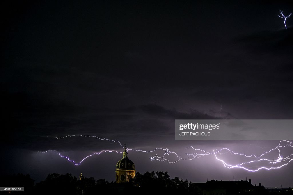 Flashes of lightning strike above the Saint-Bruno des Chartreux church, on May 22, 2014, in Lyon.