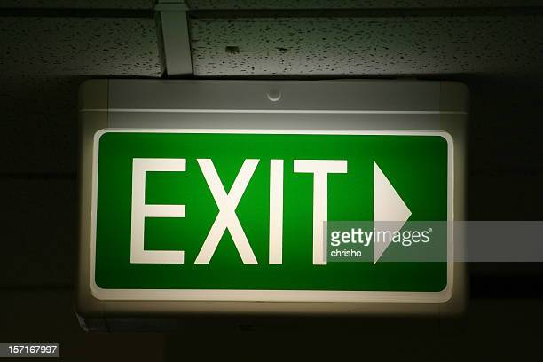 Flashing green emergency exit sign pointing to right