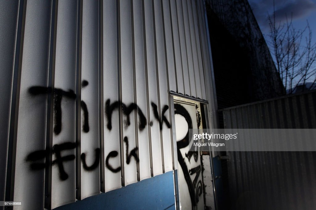 A flashlight illuminates the writing 'Tim K Fuck' on the wall of an aluminum company next to the parking lot where Tim Kretschmer died on March 4...