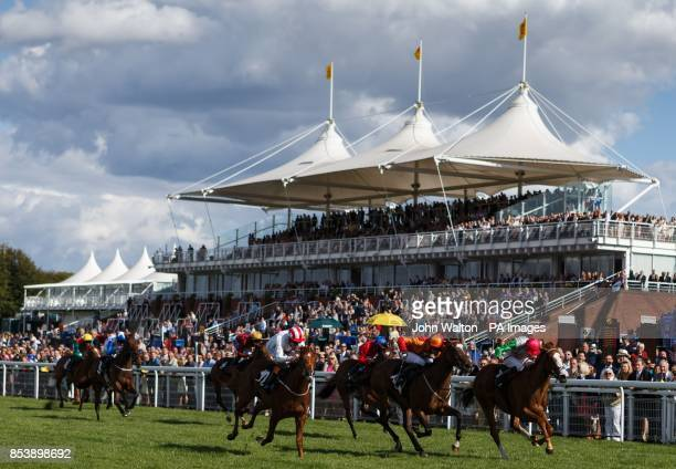 Flashy Diva ridden by Jason Doyle comes home to win The Doom Bar Maiden Fillies' Stakes at Goodwood Racecourse Chichester