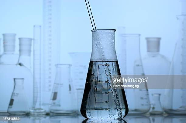 Flask with Laboratory Glassware Background