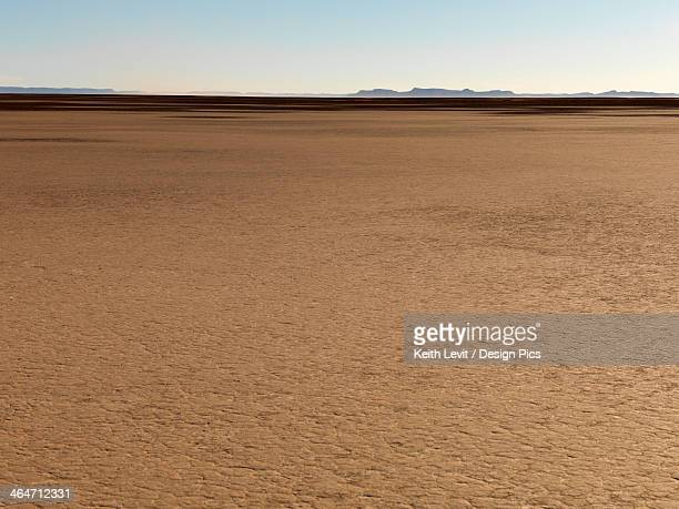 Flat Arid And Barren Landscape With Some Mountains In The Distance