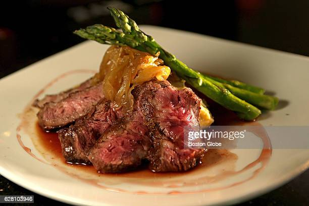 Flat Iron Steak port wine demi yukon mashed caramelized onion grilled asparagus pictured at Ko Sushi Grill on Jun 23 2015 The new restaurant which...