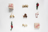 Flat lay aerial image of decoration & ornament Merry Christmas and Happy new year concept.Beautiful essential accessories on modern rustic white background at home office desk studio.Object for winter