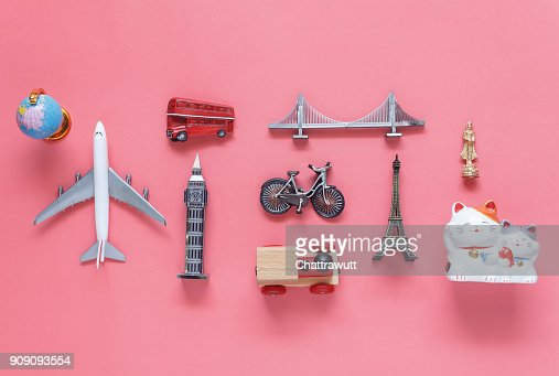 Flat lay aerial image of travel background concept.Table top view of souvenir symbol location or landmark of place for traveler all the world.objects on modern rustic pink paper.mock up & template. : Stock Photo
