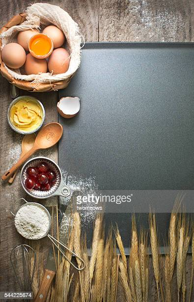 Flat lay baking utensils and ingredient on baking tray background.