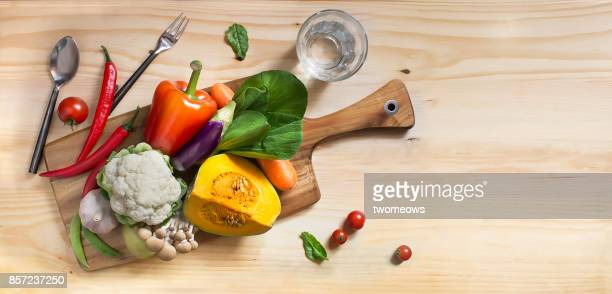 Flat lay colourful uncooked vegan food still life.