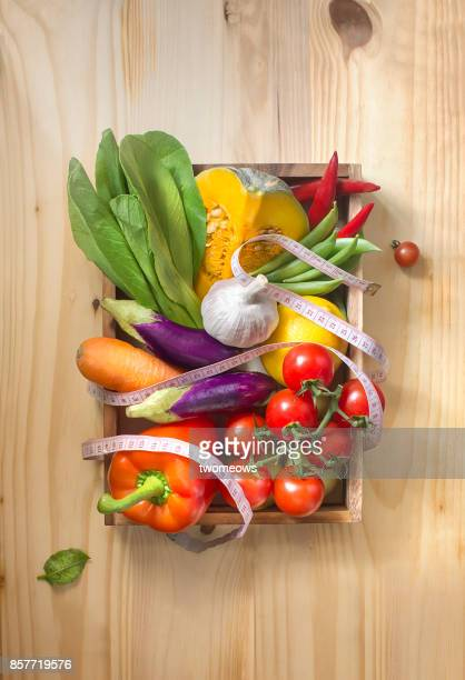 Flat lay colourful vegan food still life with measuring tap.
