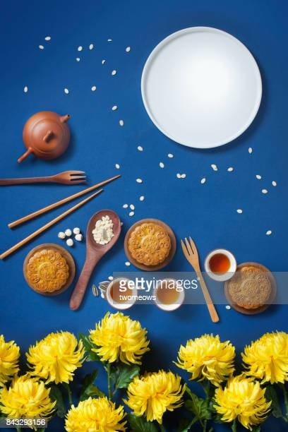 Flat lay conceptual mid-autumn festival food and drink still life.