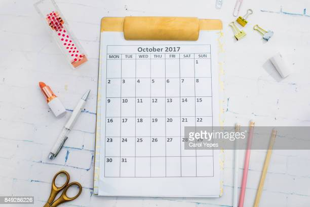flat lay desktop with october calendar