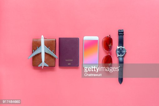 Flat lay image of accessory clothing man or women to plan travel in holiday background concept.Mobile phone & passport with many item in vacation season.Table top view several object on pink paper. : Stock Photo