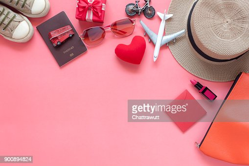 Flat lay image of accessory clothing women to plan travel in valentine's day background concept.Essential items for traveler & backpacker adult or teenage to holidays trip.Space for creative design. : Stock Photo