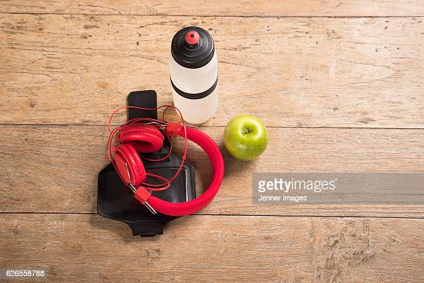 Flat Lay image of Fitness equipment on a wooden floor.