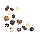 Flat lay of assortment of sweet delicious chocolate candies isolated on white