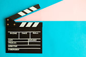 Clapper board on blue background minimal movie making and cinema film industry creative concept.