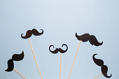 Paper prop mustached in form of birds flying up in the sky abstract minimal concept