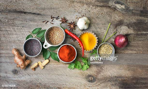 Flat lay overhead view herb and spices on rustic wooden background.