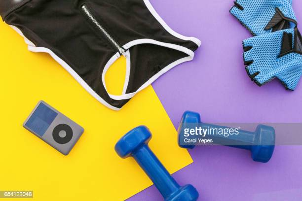 Flat lay shot of woman Sport equipment, shoes,  earphone and phone