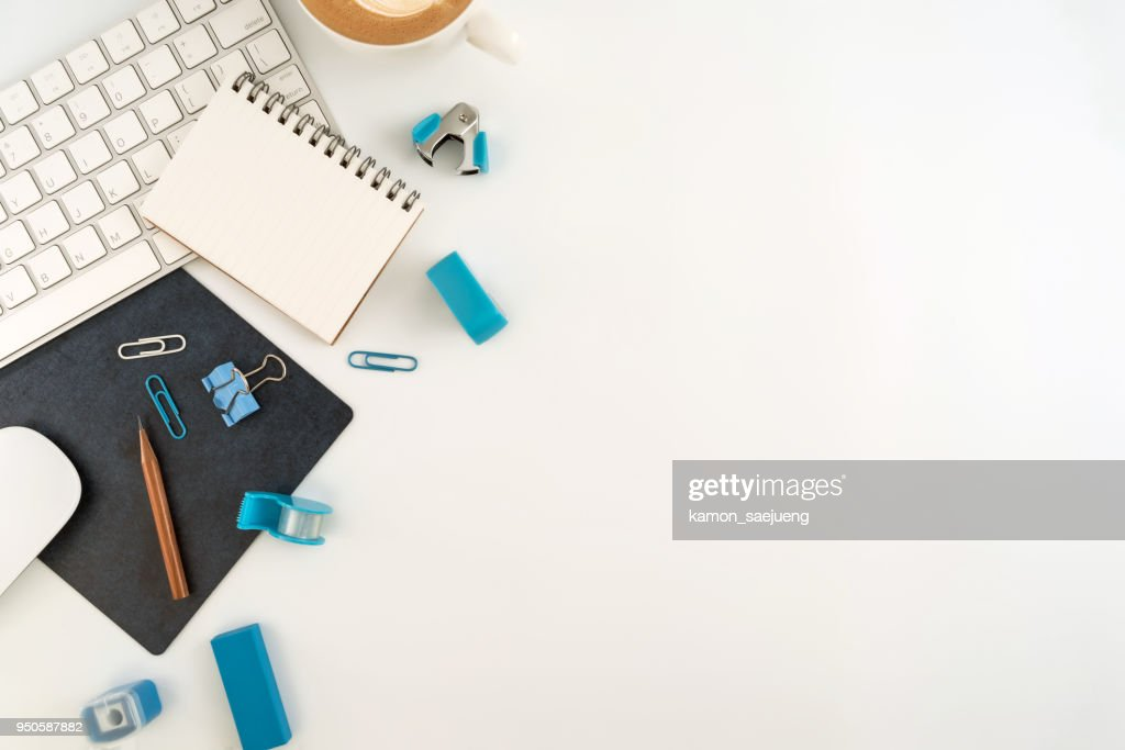Top office table cup Background Flat Lay Top View Office Table Desk Workspace With Blank Note Book Keyboard Blue Office Supplies And Coffee Cup On White Background Thinkstock Flat Lay Top View Office Table Desk Workspace With Blank Note Book
