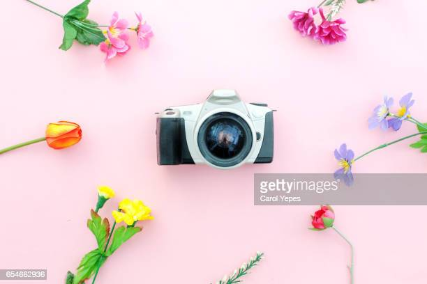 flat lay vintage camera and flowers.Springtime