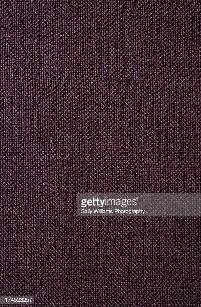 A flat maroon tablecloth background