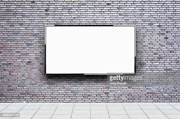 Flat screen hanging on a wall