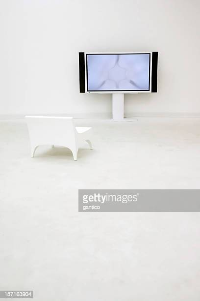 Flat screen in an empty and completely white room