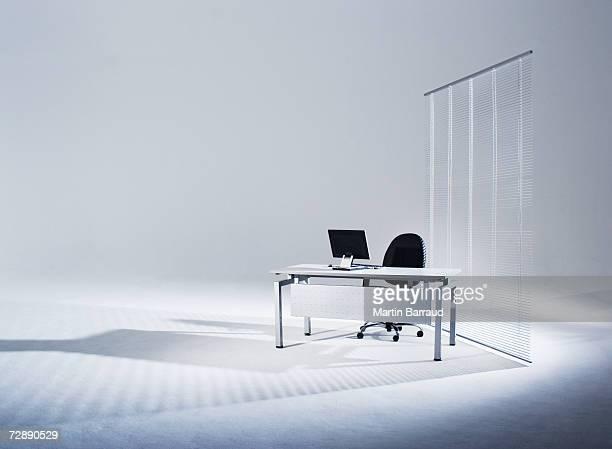 Flat screen monitor on office desk in empty studio