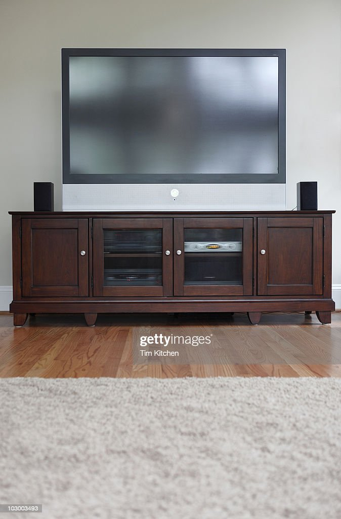 Flat screen television on cabinet in living room : Stock Photo