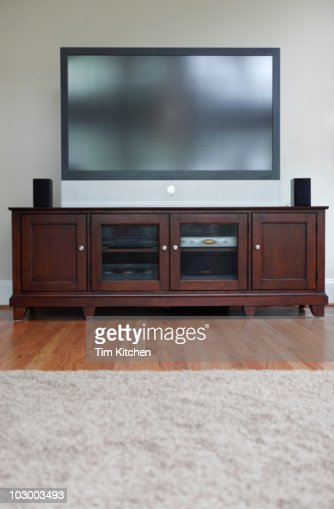 Flat screen television on cabinet in living room