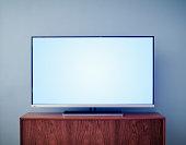 Flat screen TV on cabinet