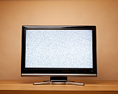 Flat screen TV with no signal, noise on screen