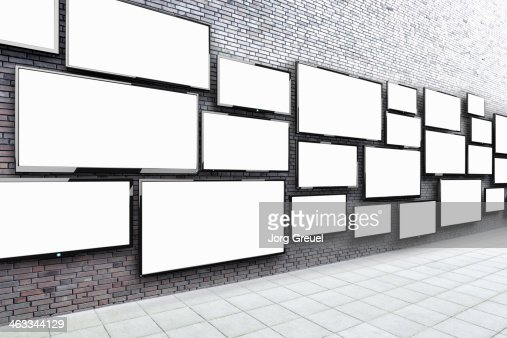 Flat screens hanging on a wall