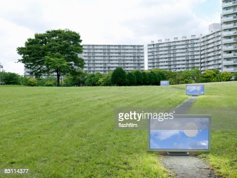 Flat TV placed in front of urban apartments : Stock Photo